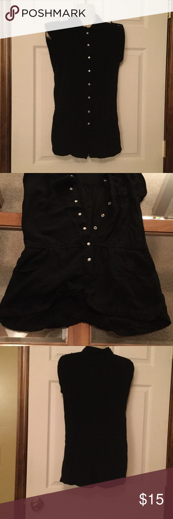 Akualani Romper Black with silver snaps down the front.  Has belt loops and 2 pockets in front.  100% Viscose made in China. Akualani Shorts