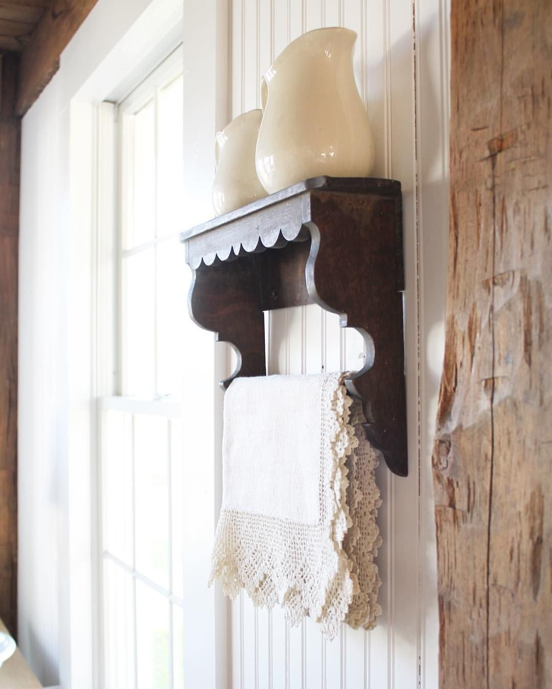 Could make the shelf with two corbels dowel and wood trim from