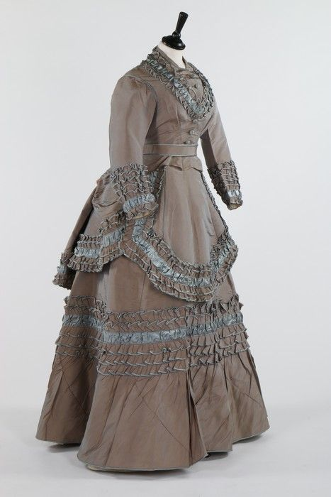Kerry Taylor Auctions Lot 115 : 1870 grey/blue shot silk dress with belt and apron over-skirt, 'Grands Magasins du Louvre' silk label applied to the skirt waist. - See more at: http://kerrytaylorauctions.com/one-item/?id=115&sub=%20&auctionid=416#sthash.HY3FTKe4.dpuf