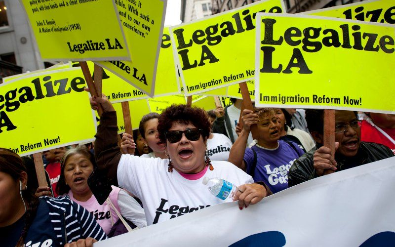 LOS ANGELES, CA - MAY 1:   May Day activists demanding immigration reform march through downtown Los Angeles marking International Worker's Day on May 1, 2012 in Los Angeles, California. Occupy Wall Street groups across the country have joined with unions during the May Day protests, a traditional day of global protests in sympathy with unions and leftist politics.   (Photo by Michal Czerwonka/Getty Images) (Photo by Michal Czerwonka/Getty Images)