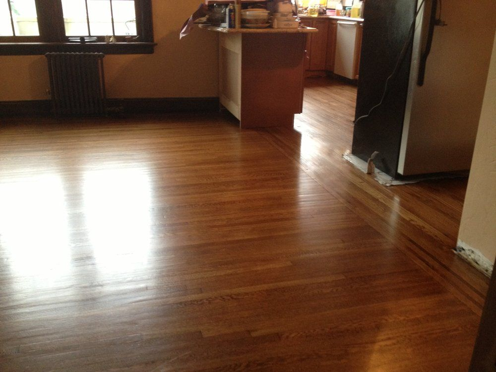 Four Corner Floors LLC - Jamaica, NY, United States. Sanded, stained gunstock color with a satin finish.