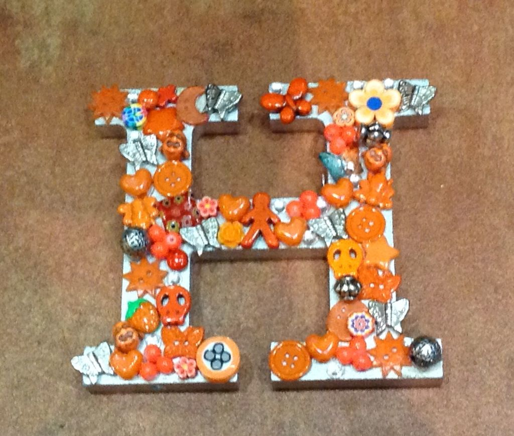 Wooden letter H, Decorated in orange and silver colors