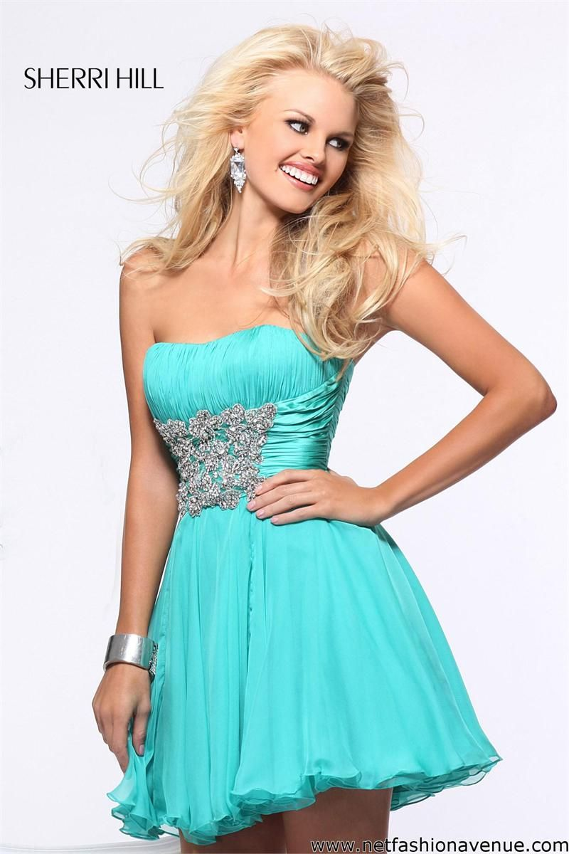 This teal dress looks great on anyone with spring toned skin. Any ...