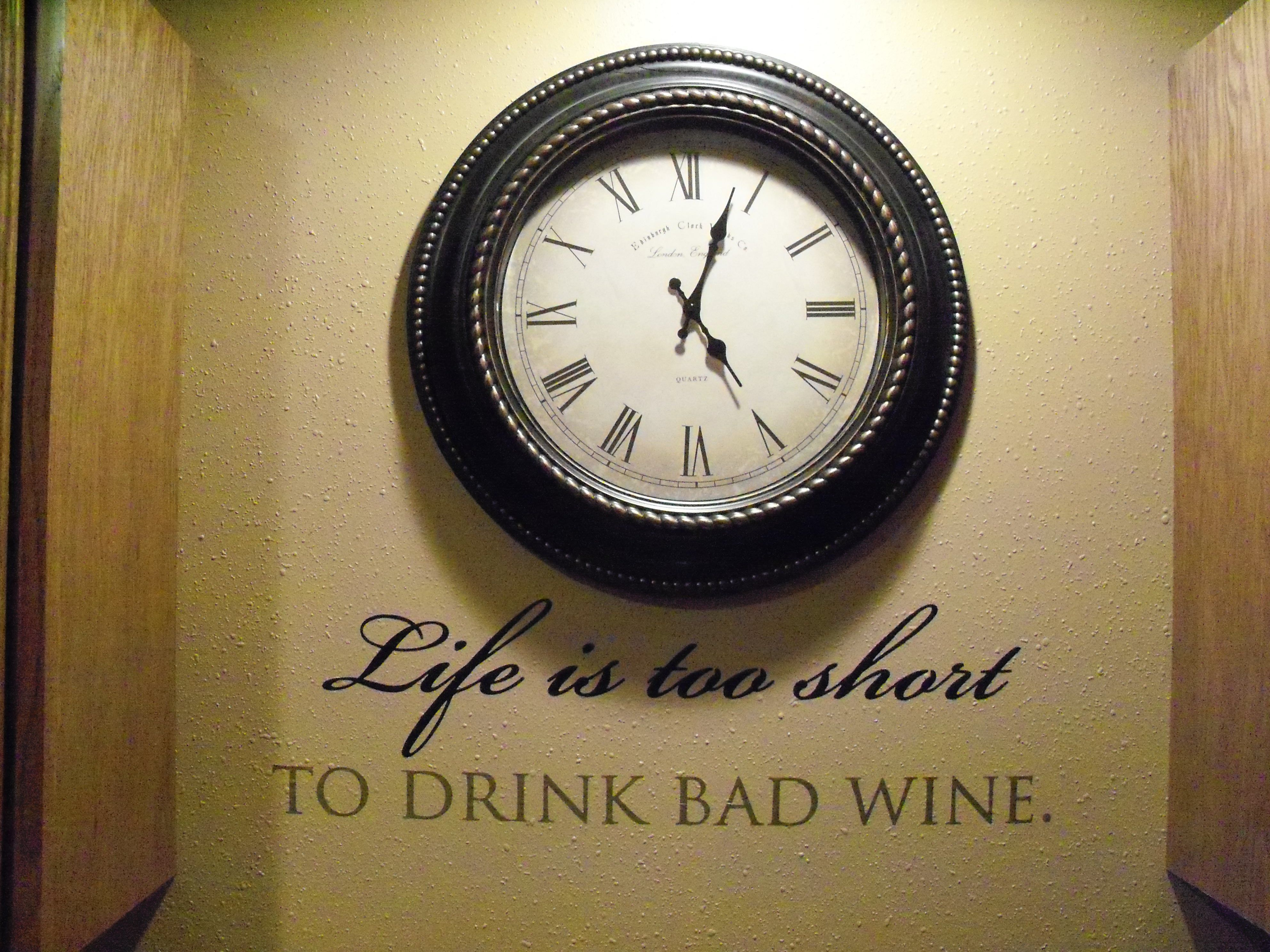 My new wall with clock and wine saying in my basement my dream
