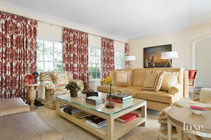 traditional neutral family room with red accents  luxe