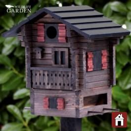 "I'ts a Swedish ""chalet"" for the #birds! And it's a multifunctional one too! In the top section birds can build a #nest and raise a family in spring, the bottom section can hold grains and other food in the winter."