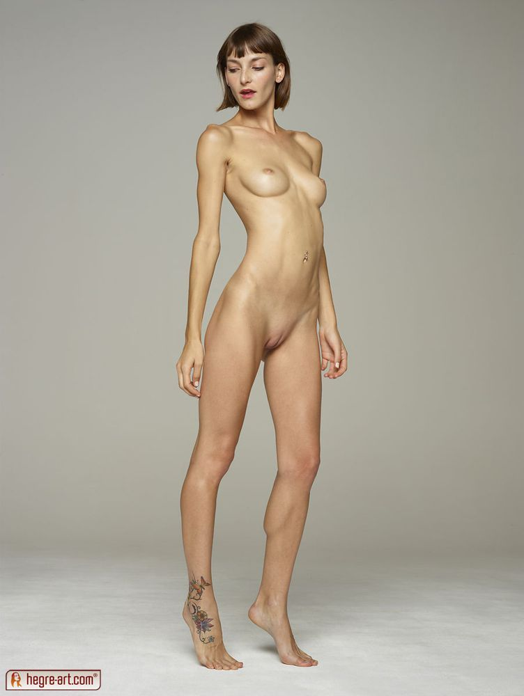 nude model standing in studio photo from nicelynude