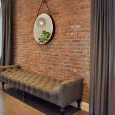 Living Room With Rustic Brick Wall, Grey Curtains
