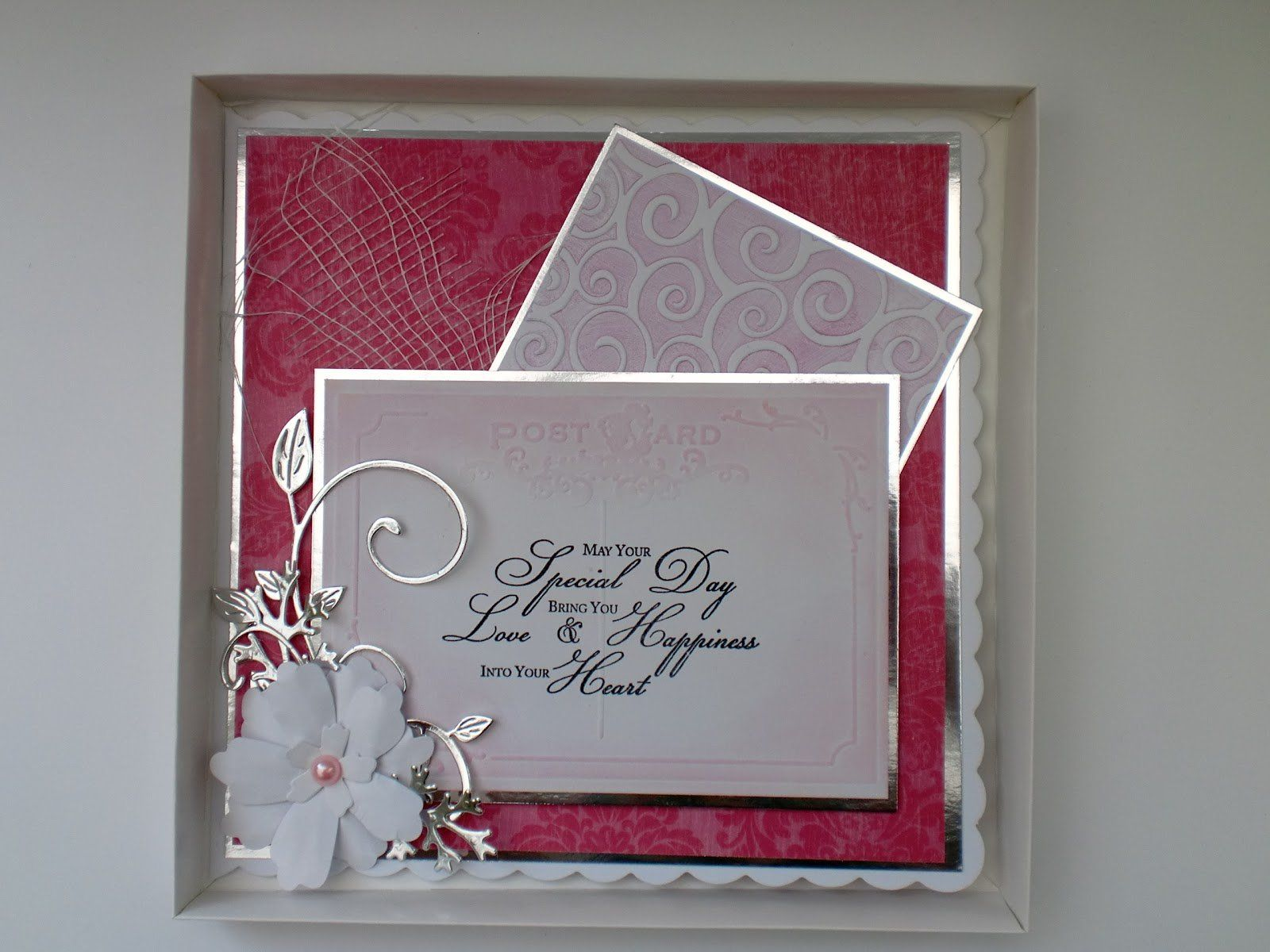 Elegant white and grey color scheme for wedding anniversary card