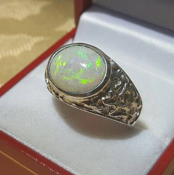 Check out this item in my Etsy shop https://www.etsy.com/listing/398110403/550-carat-genuine-australian-opal-mens