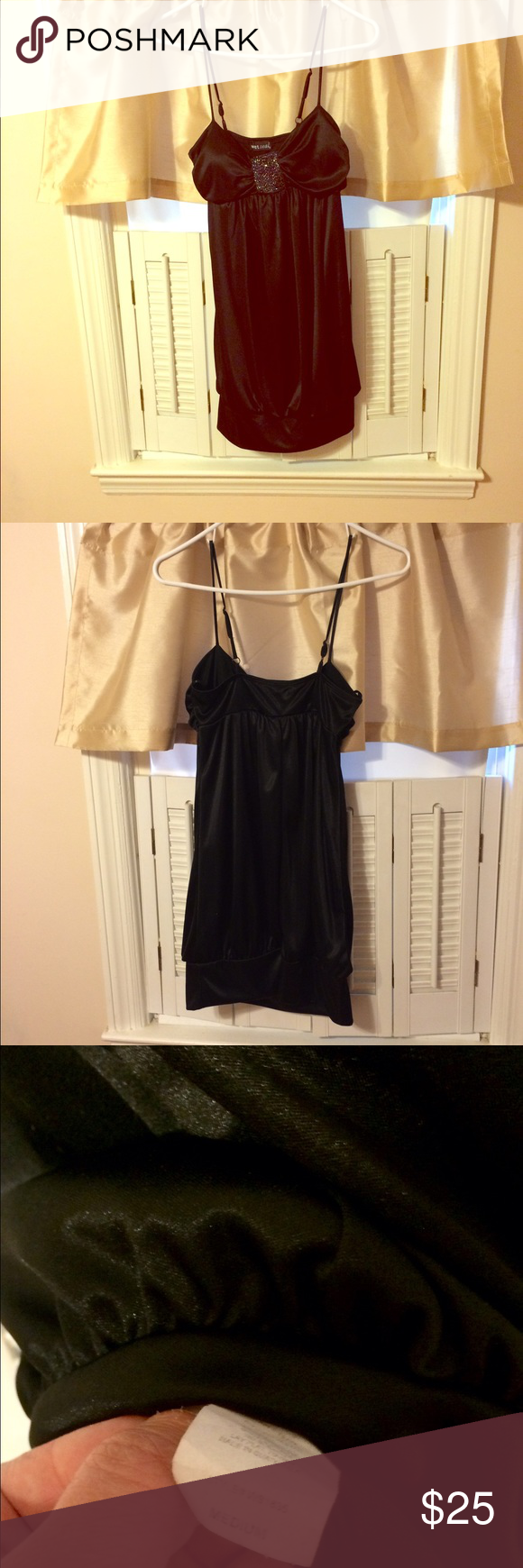 Black jeweled dress This gorgeous 100% polyester, black dress has a satin look and feel. Has a perfectly in tact jeweled pattern on the front side. Adjustable straps and a fitted black band at the bottom. Ultra sexy and in near perfect condition. Wet Seal Dresses Mini