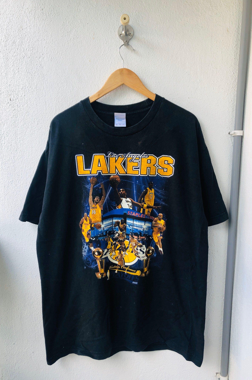 Grab It Original Los Angeles Lakers Kobe Bryant Era Champion Merchandise T Shirt In 2020 Shirts Lakers Graphic Shirts