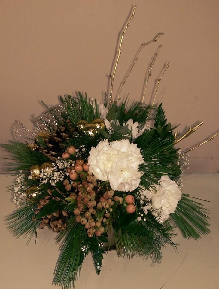 A quant winter greens arrangement.