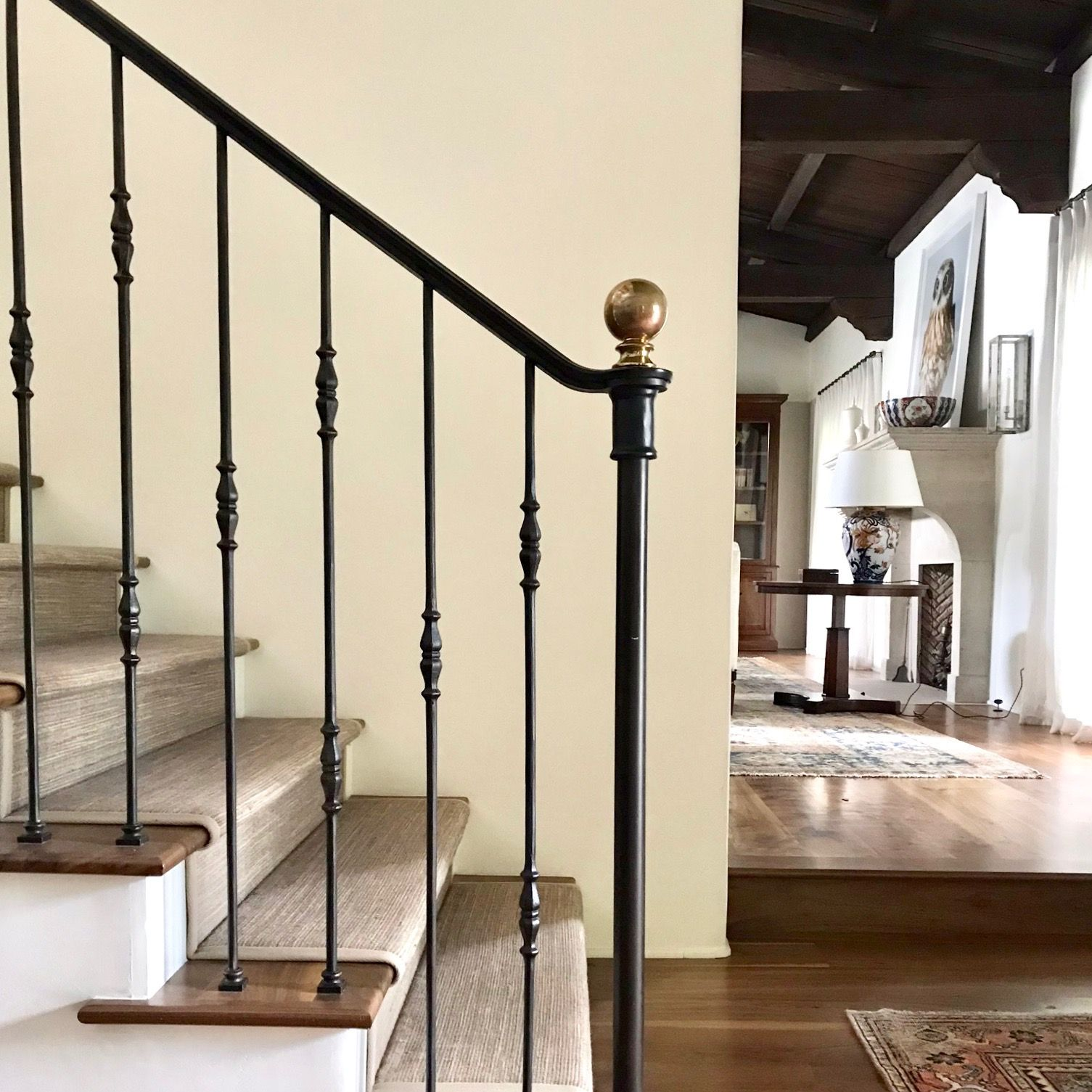 Custom Designed Iron Stair Rail With A Perfectly Aging Brass Newel