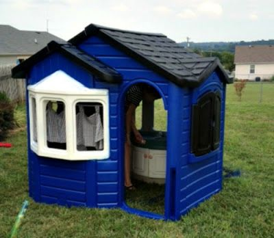 A Little Tykes playhouse and plastic spray paint in the ...