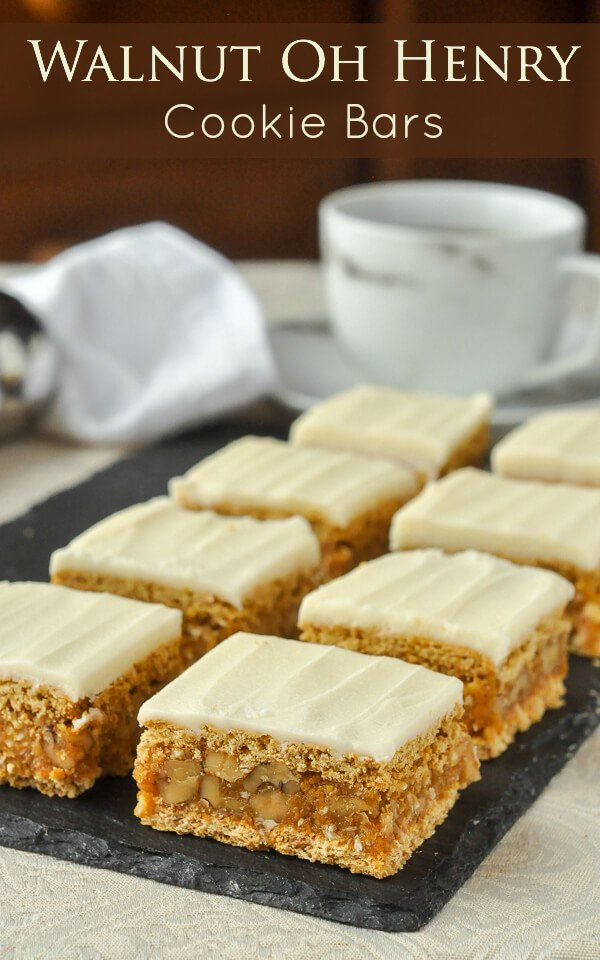 Walnut Oh Henry Bars - a scrumptious no-bake cookie bar with a caramely, nutty centre sandwiched between graham crackers and topped with sweet vanilla buttercream frosting.