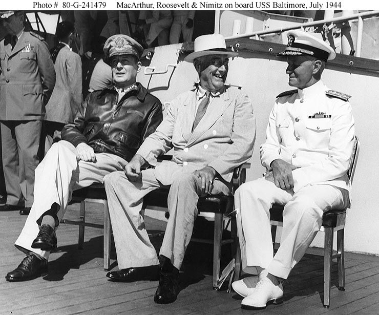 Gen. Douglas MacArthur,  President Roosevelt, & Nimitz aboard ship USA Baltimore in July 1944.