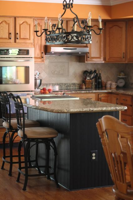 Like the wall oven and stovetop config also like the oak for Black beadboard kitchen cabinets
