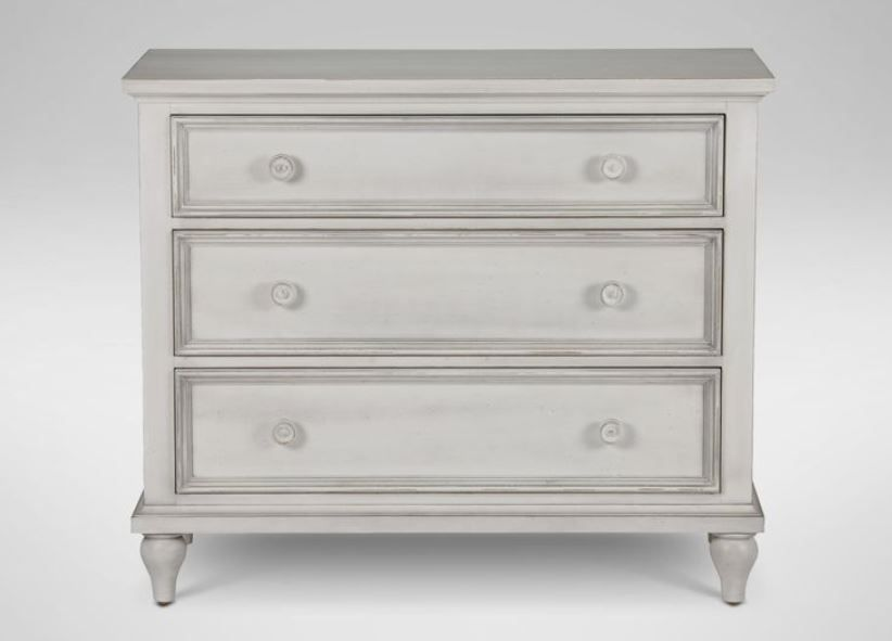 Reagan Chest   With clean, simple lines and subtle design details like tapered bun feet, this chest offers traditional styling at its best. It features three drawers with self-close glides and fronts accented with small painted knobs. Available in an array of beautiful finishes.