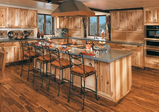 Rustic hickory cabinets in a natural stain show tons of Kitchen colors with natural wood cabinets