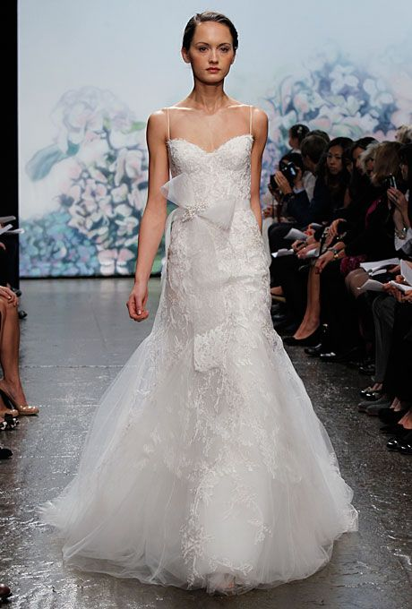 "Brides: Monique Lhuillier - Fall 2012. ""Cherish"" Chantilly lace and embroidered tulle mermaid wedding dress with a sweetheart neckline, spaghetti straps, and bow sash, Monique Lhuillier"