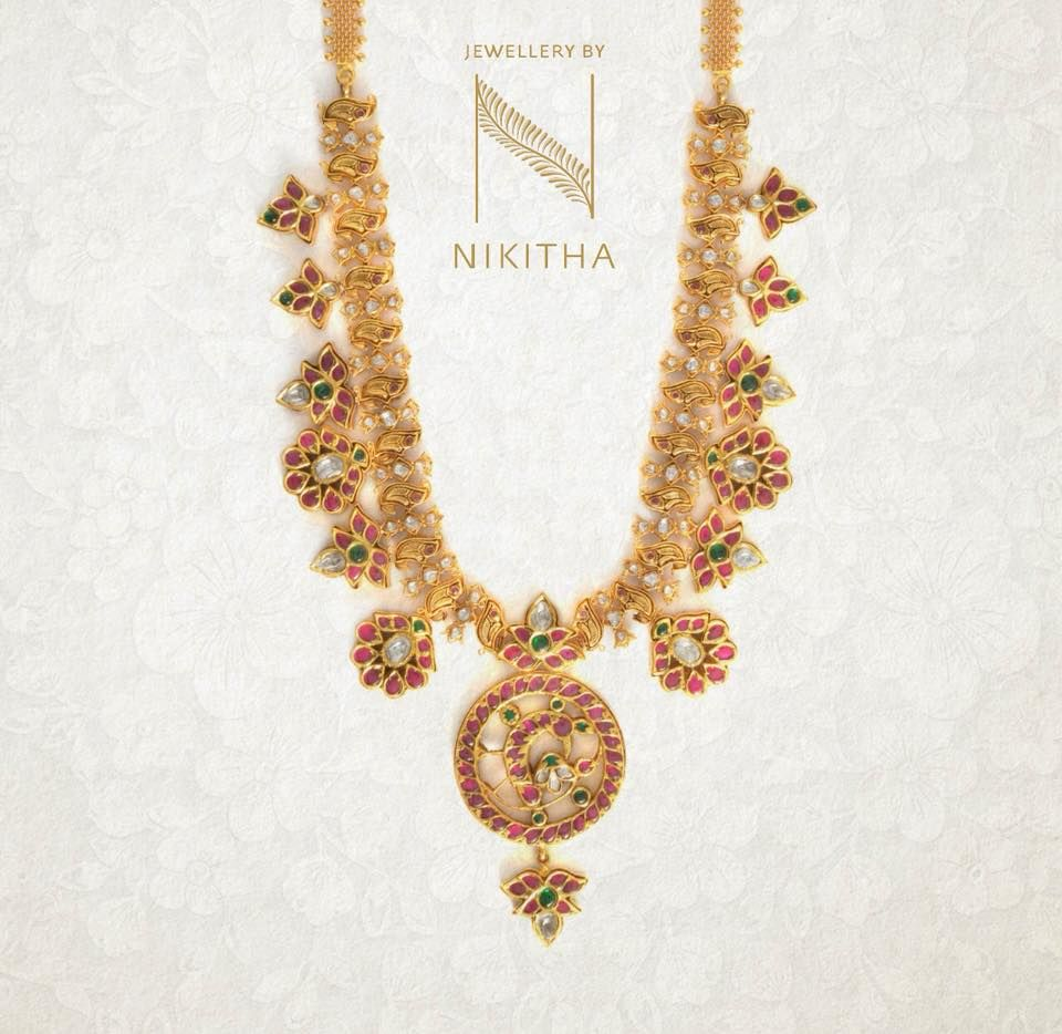 Indira a gold emerald and rubies necklace set to set you apart