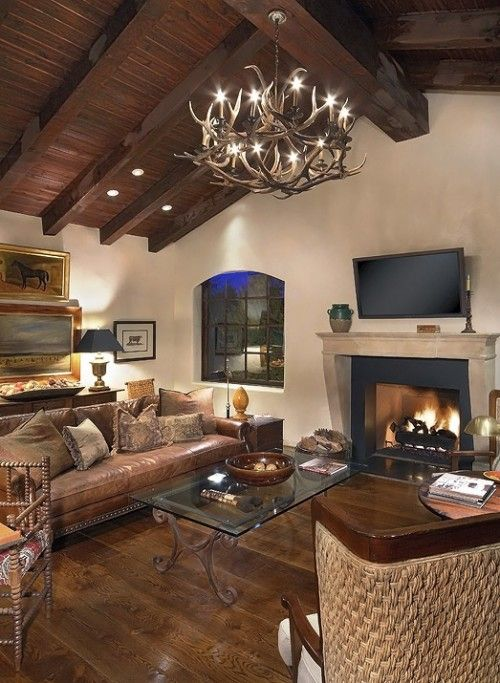 tv above fireplace in living room with vaulted ceilings