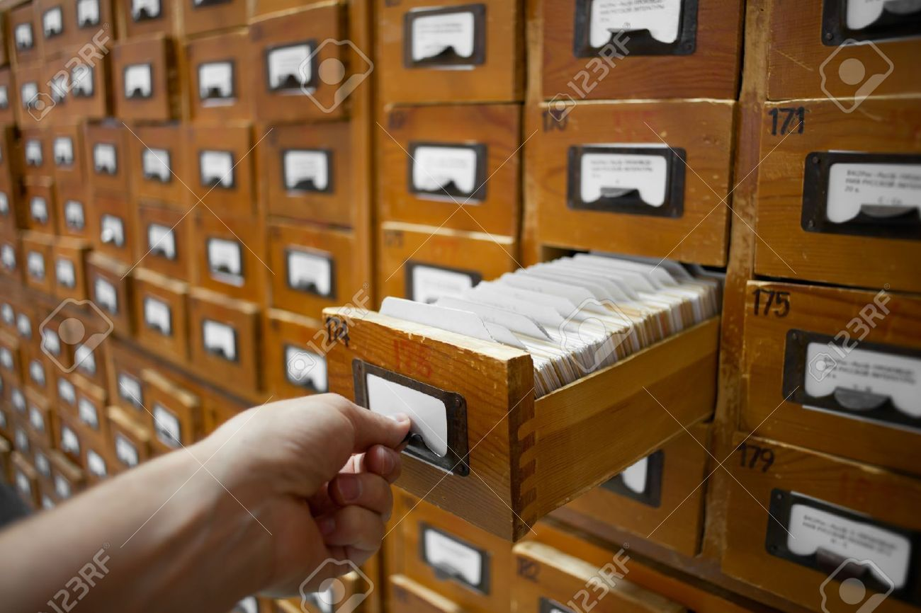 index card file box: database concept. vintage cabinet. human hand opens library card