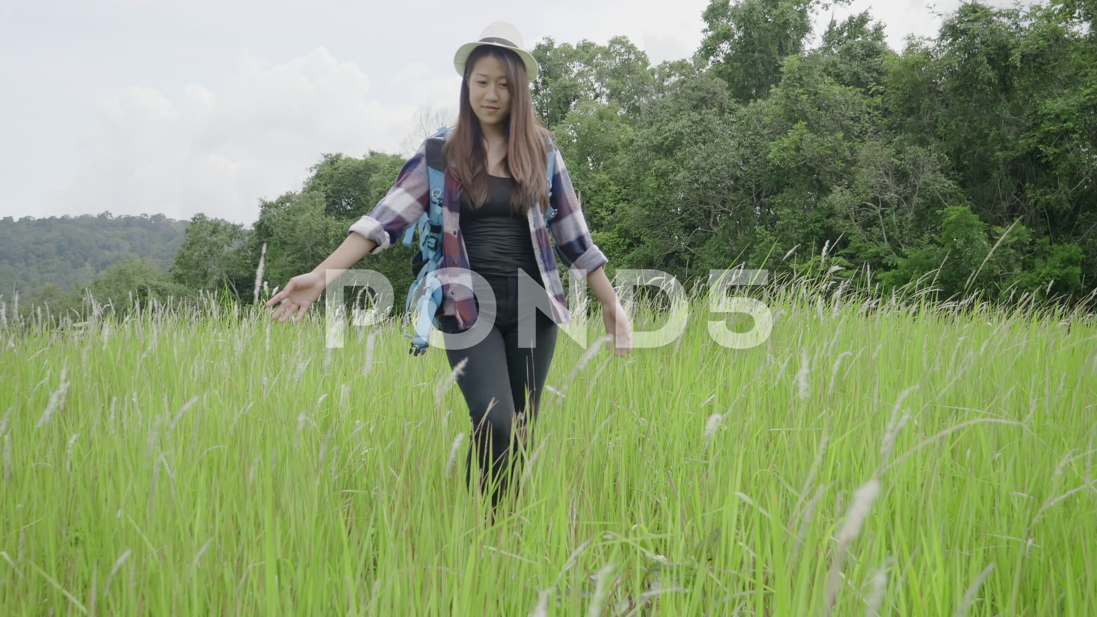 Lifestyle Asian young women walk in nature Travel forest Stock Footage womenwalkyoungLifestyle