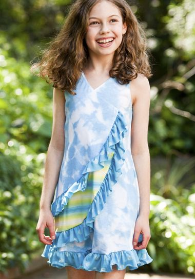 This kids ruffle dress comes with a big smile. Don\'t believe me ...