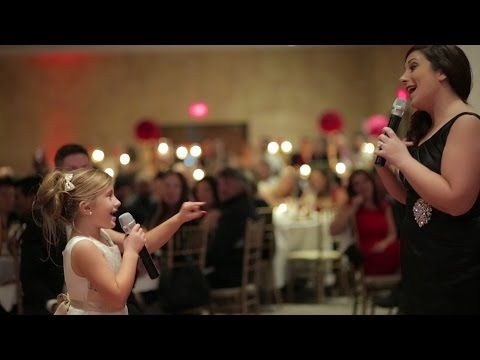 """This Flower Girl And Her Mom Singing """"Love Is An Open Door"""" Are Just Way Too Cute"""