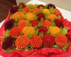 Chrysanthemum Cupcakes  Chrysanthemum Cupcakes Pumpkin spice flavored cupcakes made to look like mums.  #chrysanthemum #gumpaste-flowers #fall #cakecentral