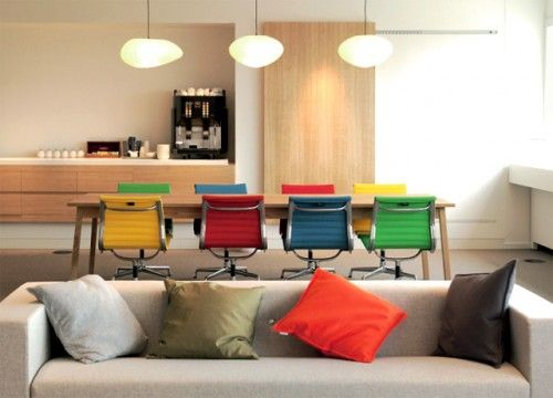 eames aluminum management chairs in fun, bright colors.