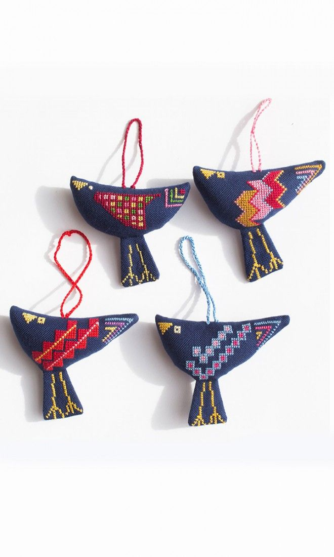 These colorful bird ornaments are hand-stiched by Palestinian women living in Gaza's refugee camps and carried out of the Gaza Strip by the United Nations. The traditional embroidery technique used to create these birds has been passed down through generations of Palestinian women. The birds offer a symbol of peace and hope from a part of the world historically plagued with conflict. ==