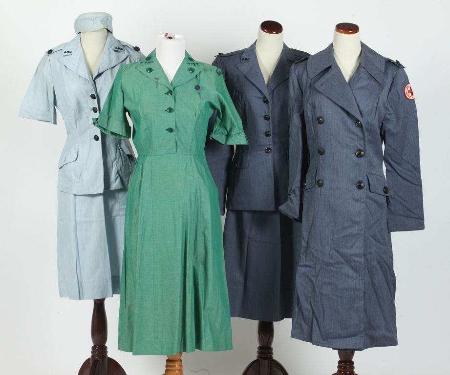 Selection of vintage Red Cross and Girl Scout uniforms.