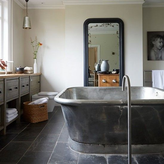 Industrial-style bathroom with large tin-finish bath | Modern ...