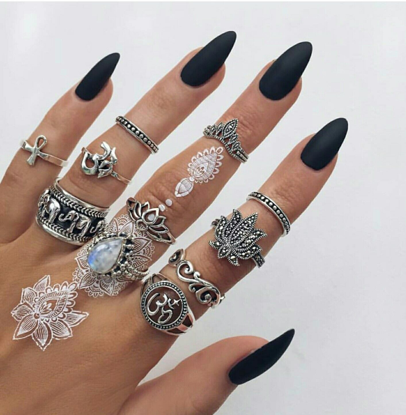 Matte black almond shaped nails and silver stacked rings | {Mani ...
