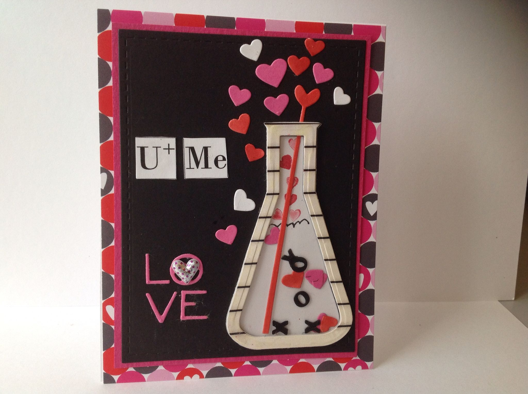 "Love my new dies for Valentine's Day from Taylored Expressions. I made a shaker card and then added the U & Me from my printer to look like symbols from the periodical table. Inside I added ""We've got chemistry!"" Great papers from TE too!"
