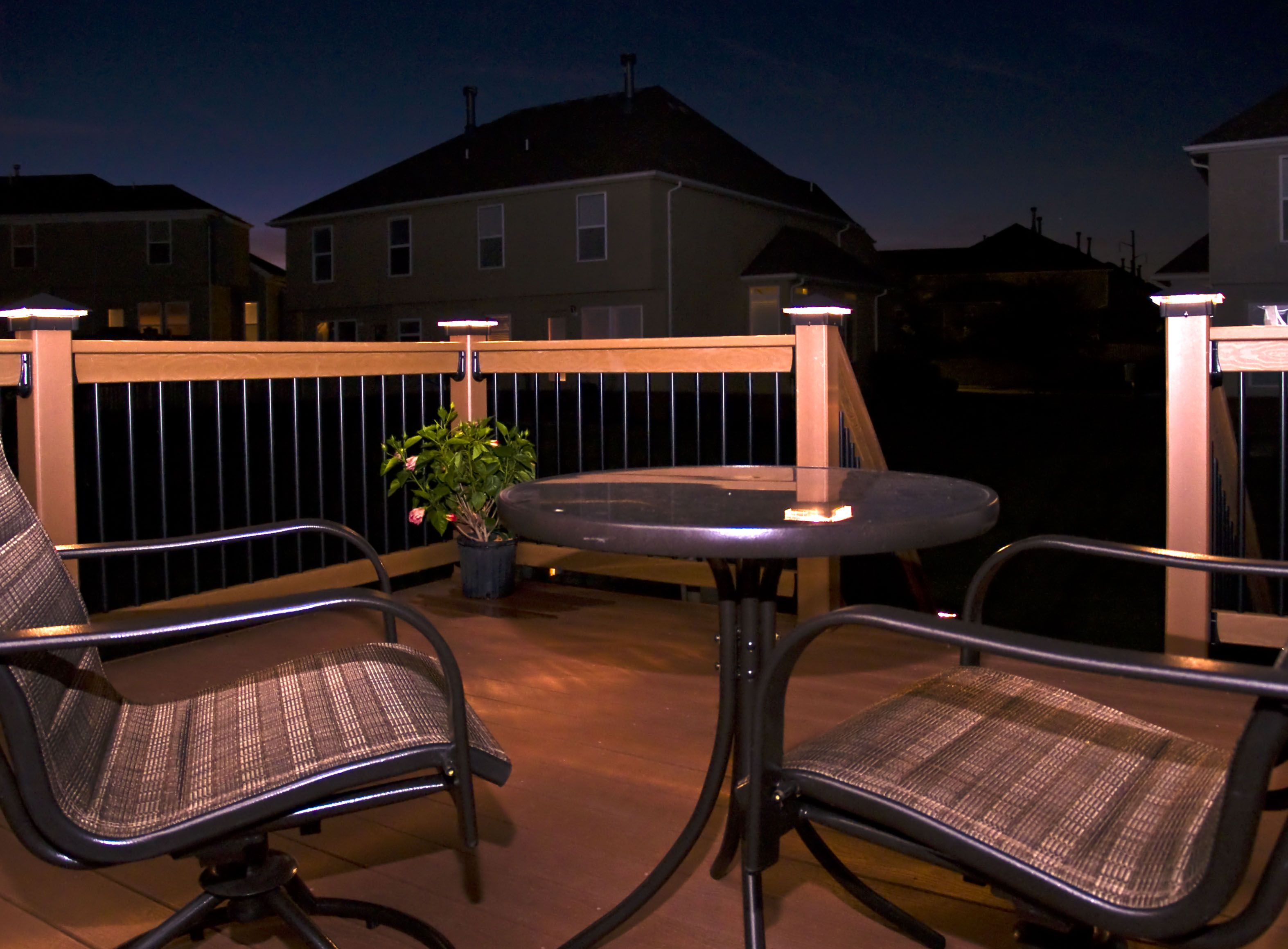 EverGrain Deck (Redwood) with Moonlight Decks post lights in Olathe, KS