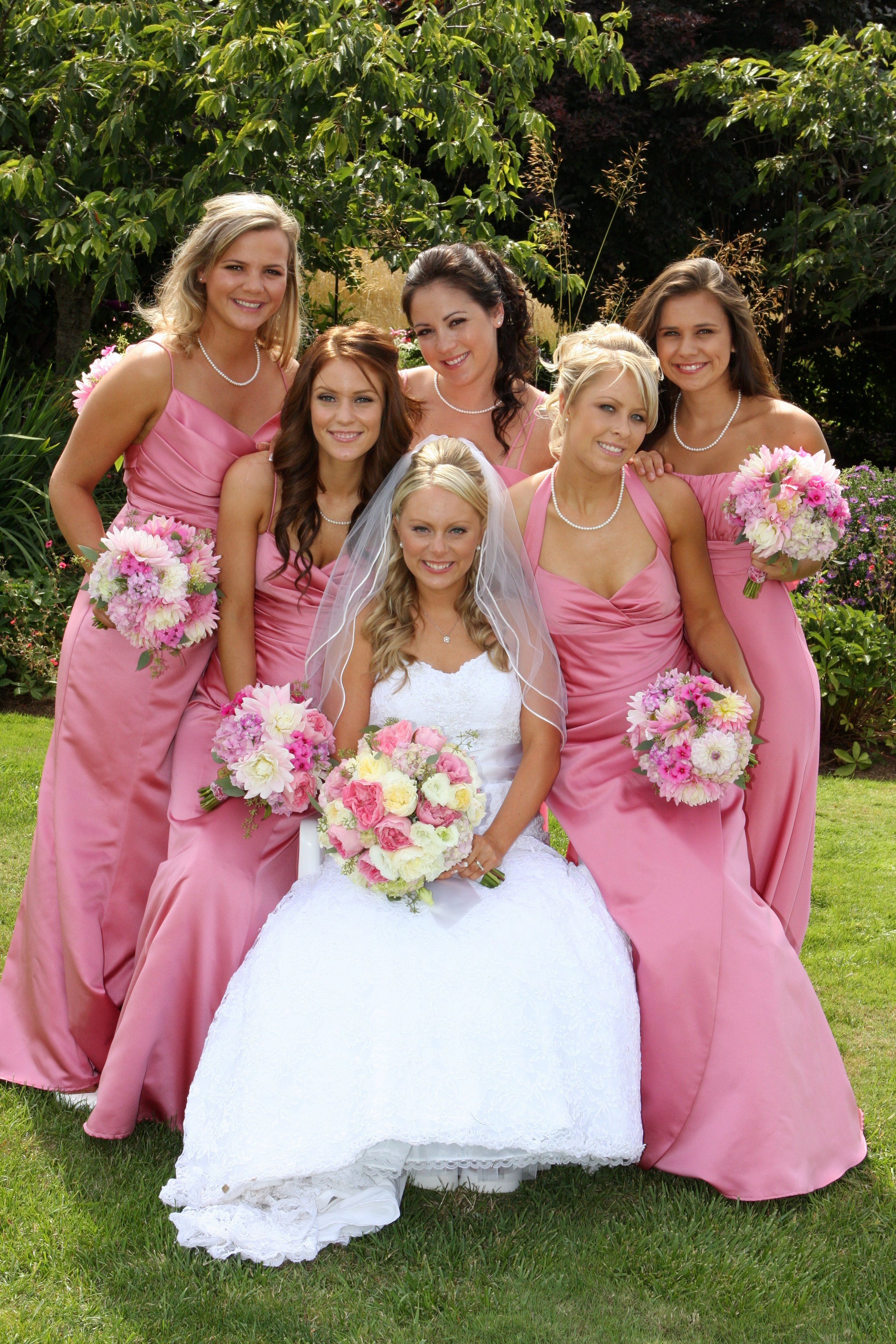 Pink bridesmaid\'s dresses. Same color, each in a different style ...