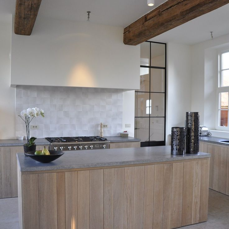 White washed cabinets, concrete counter tops, white walls ...