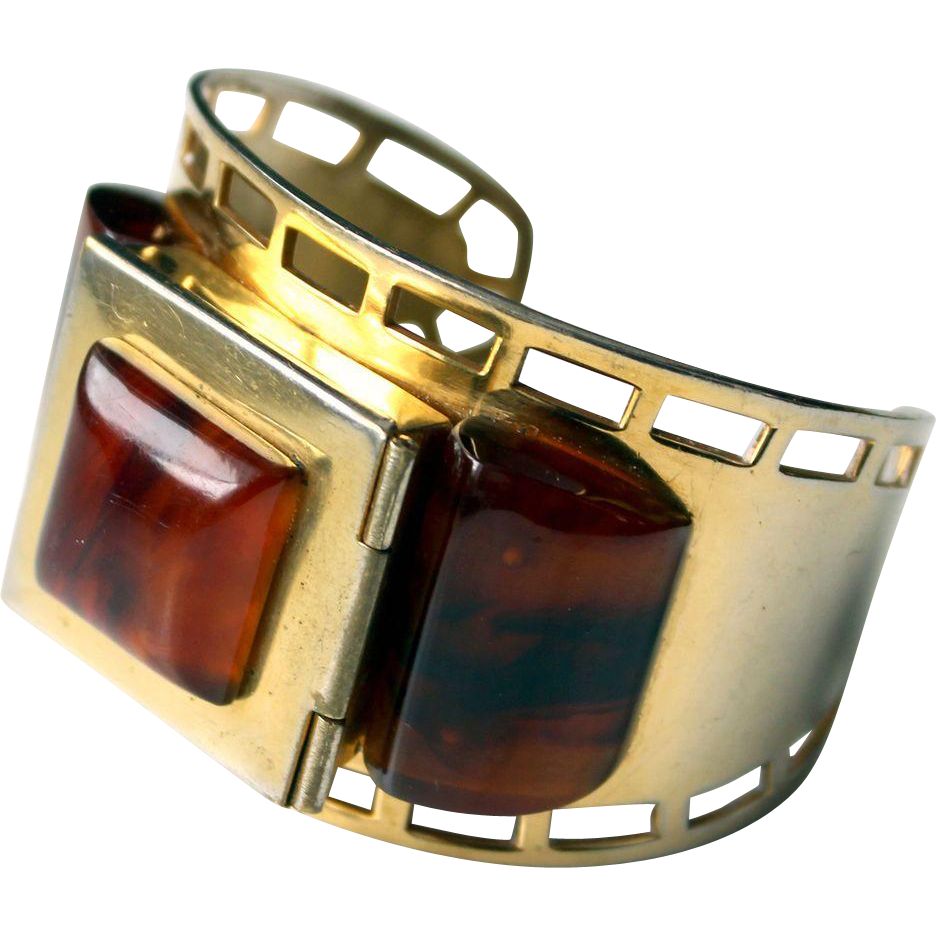 1930s French bracelet  with marbled brown bakelite gold tone  brass powder compact cuff made in France in the 1930s by the Parisian Albert  FLAMAND.