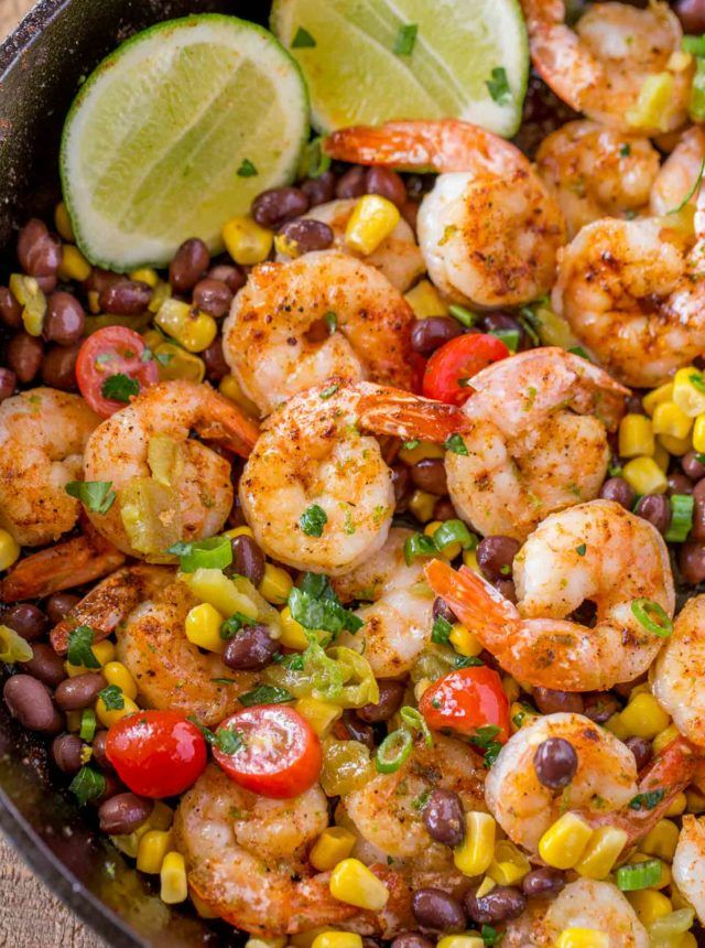 Mexican Shrimp Burrito Bowl made with spiced shrimp, corn, black beans, tomatoes and chilis tossed with a honey lime glaze for just 1 smart point per serving! #mexicanshrimprecipes