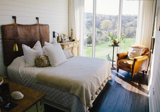 """""""When you sleep in the bedroom space, you feel like you are in a treehouse surrounded by the stars at night"""" Tour this former horse stable through the link in our bio. #myhouzz  #farmhouse"""
