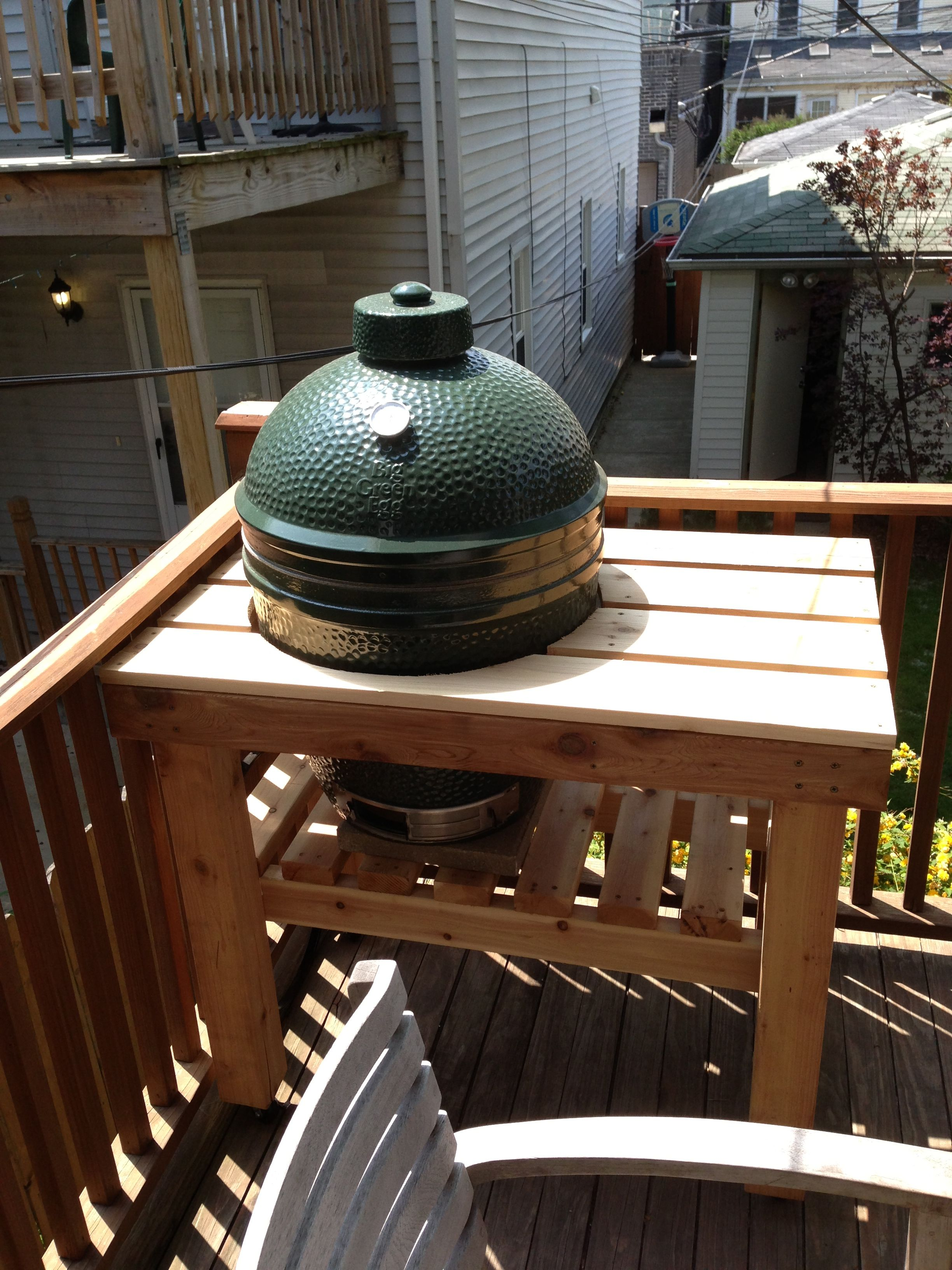 Green Egg in Cedar table in the happy spot on the deck.