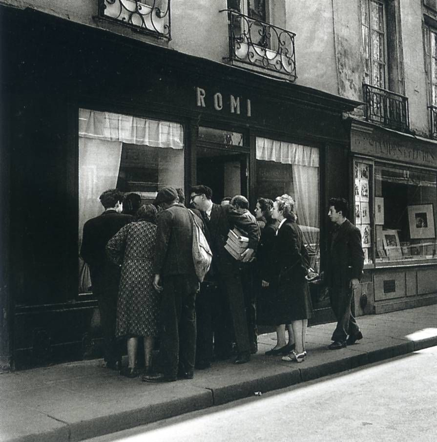 "Robert Doisneau, ""Le regard oblique, in front of the store Romi, rue de Seine, Paris 1947 © Atelier Robert Doisneau"