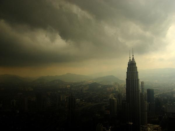 Banks Of Dark Grey Clouds Build Up Around Malaysia S Most Famous Urban Landmark The Petronas Towers