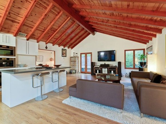 The Open Floor Plan Exposed Rafters And Modern Touches
