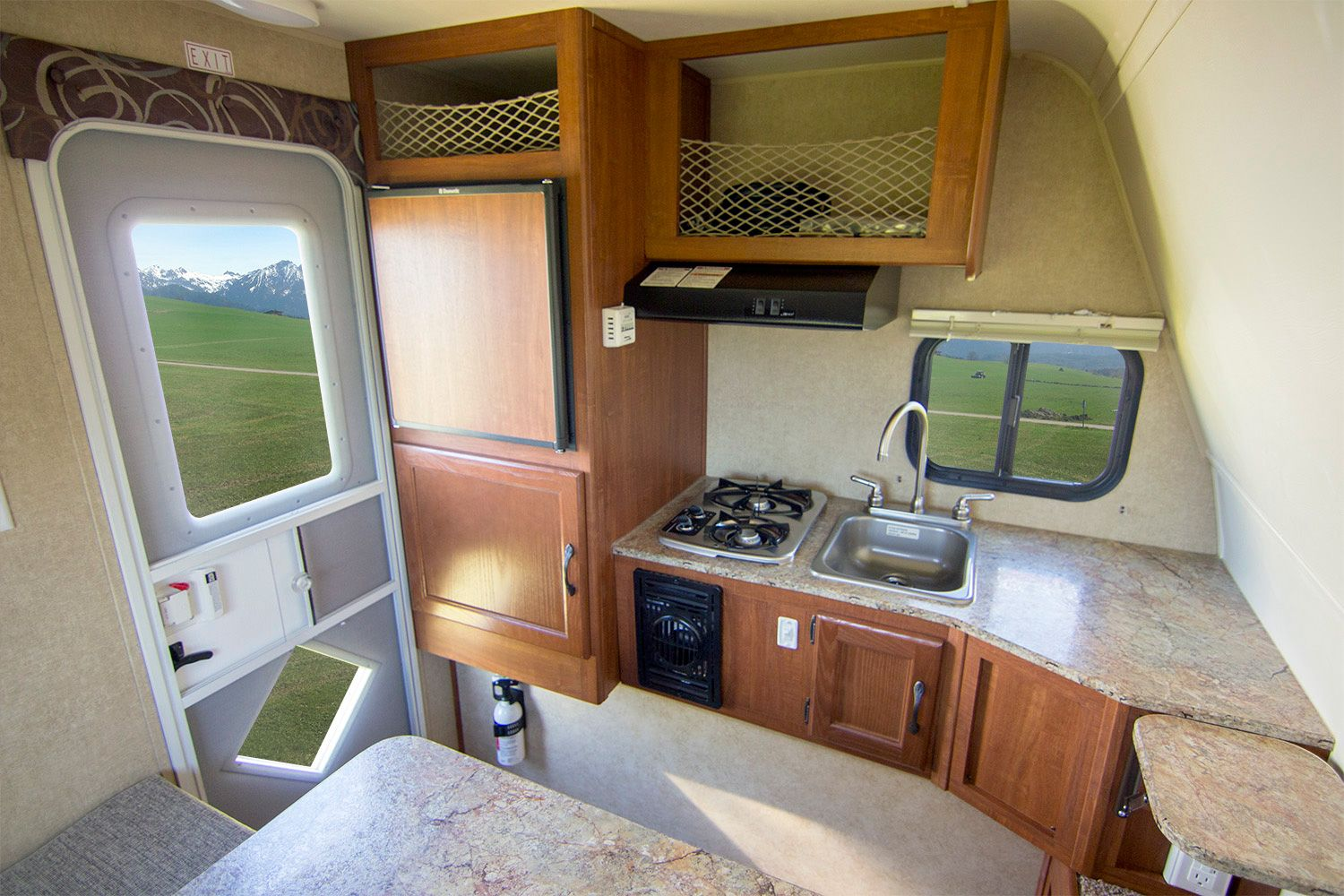The Rayzr FK is a hard side cabover-less camper with a front kitchen