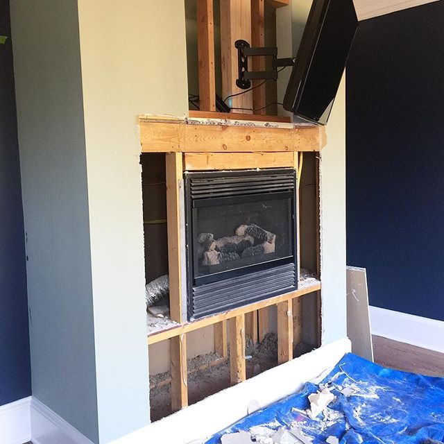 Felt like the right week for a little demo! 😉 I can not WAIT to see the tile up on this fireplace and finally get some shelving up.  The question at this point is...would you wrap the entire thing with tiles (they are really pretty white natural cut stacked stone) or would you just do the front and leave the sides painted?  My gut says wrap.  What say you?! 🤔🤔🤔 #decisionsdecisions